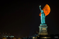 Lady Liberty and the setting moon